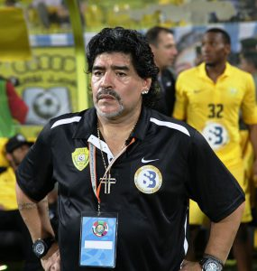 800px-Maradona_at_2012_GCC_Champions_League_final